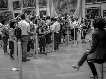 "At the ""Mona Lisa"" by Leonardo da Vinci, Musee Louvre, Paris, France"
