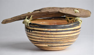 Clay vessel with driftwood