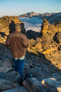 A student in a private landscape photography workshop photographing sunset at the Rock Cut, Trail Ridge Road, Rocky Mountain National Park, Colorado