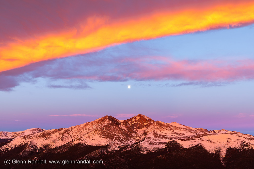 The full moon setting over Longs Peak from the summit of Twin Sisters, Rocky Mountain National Park, Colorado