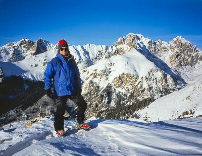 Glenn Randall atop Peak 12,847 in January with Kit Carson, Crestone Peak, and Crestone Needle behind, Sangre de Cristo Wilderness, Colorado