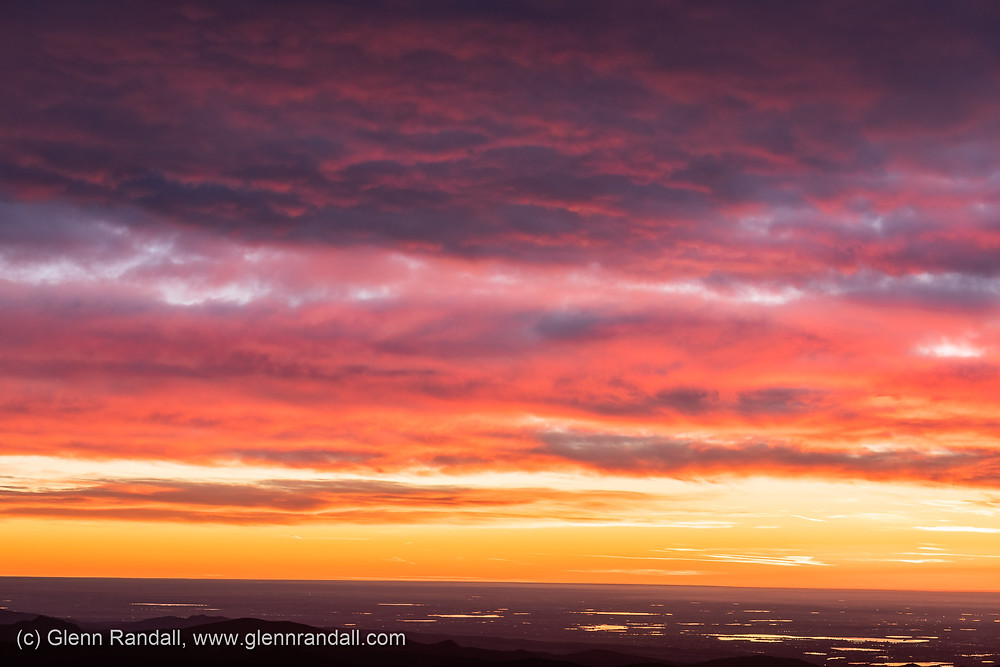 Figure 2. Glowing clouds over the eastern plains of Colorado about 10 minutes before the almanac time of sunrise, taken from the summit of Twin Sisters, Rocky Mountain National Park, Colorado.
