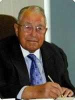 Mr. John G. Wilson, Co-founder