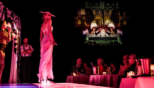 Risque Revue stage view of tables and pr