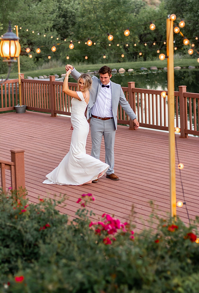 First dance for bride and groom in a fitted white wedding dress under twinkle lights at an outdoor wedding venue. Southern utah wedding planner Zion wedding venue zion wedding planner outdoor wedding venue decor