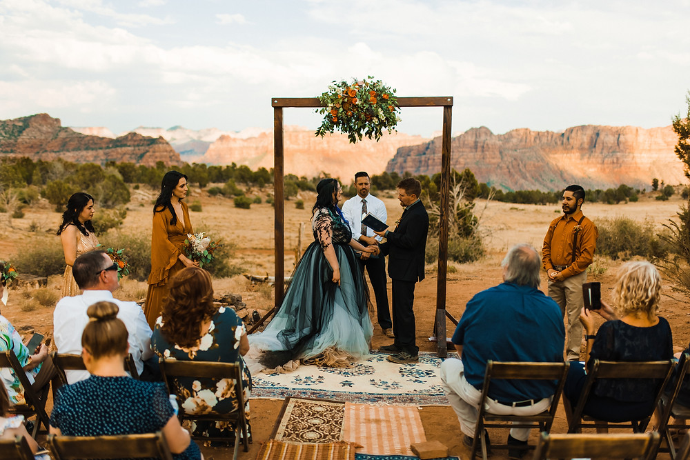 Wedding Ceremony and Wedding Arch with Assortment of Rugs for the wedding aisle in Zion National Park. #Weddingceremonyarch #weddingarch #ceremonyarch #weddingflowers #smallwedding #weddingphotos #weddingphotography #utahwedding