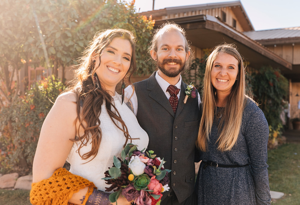 Couple smiling with their Event Planner and Coordinator on their wedding day with bridal bouquet. #weddingdress #weddingplanner #weddingplanning #bridalbouquet #brideandgroom #burnettebride #eventplanner #weddingday #weddingphotography