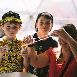 Two boys playing with Slime Princess Slime