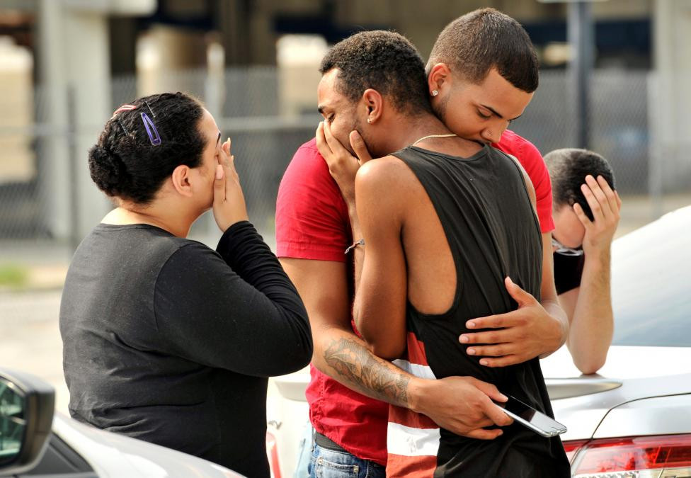 Friends of victims comfort one another after the shooting in Orlando. Picture from  Reuters / Sunday, June 12, 2016
