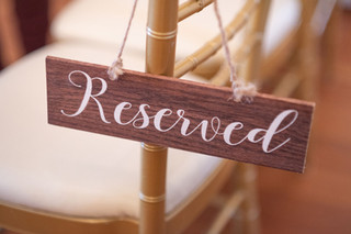 Reserved Wooden Sign with White Font