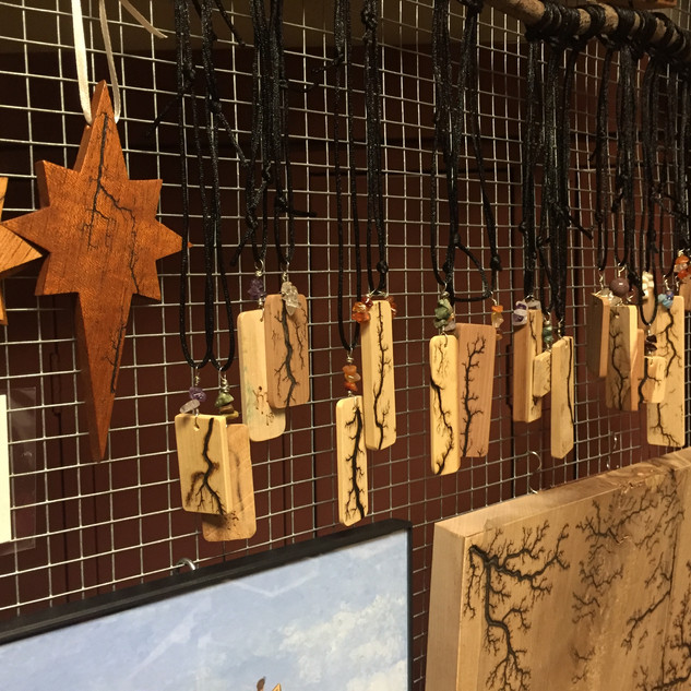 Collection of pendant necklaces and star ornaments