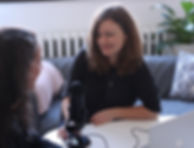 woman in black half-sleeved shirt sitting while facing woman and smiling_edited.jpg