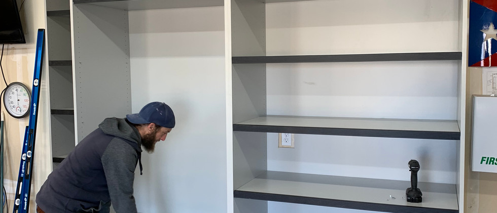 INSTALLING THE SHELVES. THEY ARE ADJUSTABLE AND CAN BE REORGANIZED AT ANY TIME