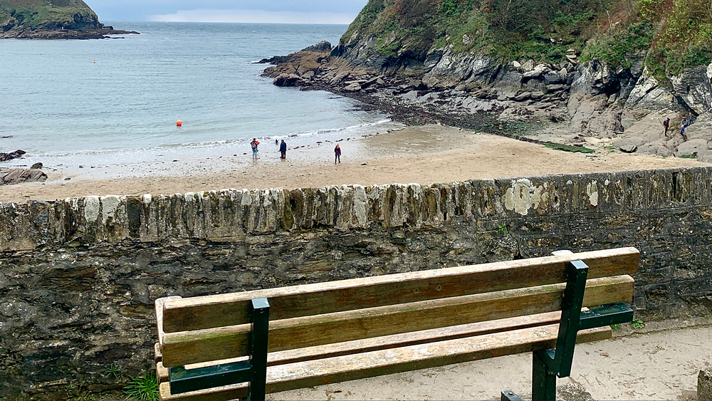 A wooden bench on top of the limekiln at Readymoney Cove, Fowey, Cornwall
