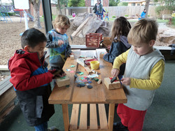 Busy at the woodwork table