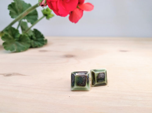 Tiny geometrical earrings made of porcelain and copper oxide