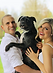 dog trainer with owners and pitbull