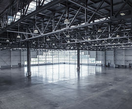Interior of an empty warehouse with glas