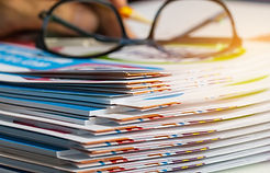 Stack of report paper documents for busi