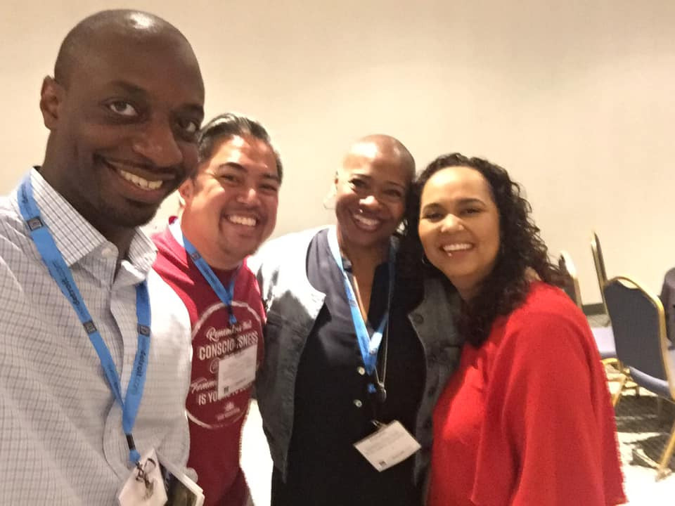 Nathan Victoria with the other panelists and moderator of the session smiling for a selfie.