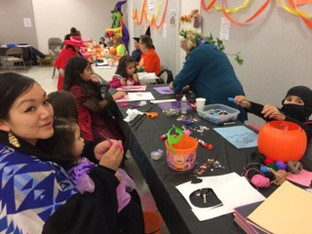 Volunteer Christy working abooth at the Harvest Fall Festival