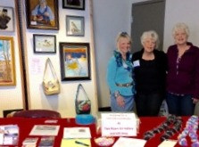 Bev Ott, Joanne Campbell and Judy Pate working the booth at Winter WIngs