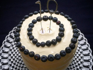 Lemon and poppy seed birthday cake with buttercream icing and blueberry cream