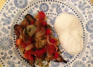 Aubergines with tomato, onion and garlic