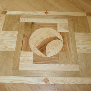 Custom designed parquet floor made from wood milled on site