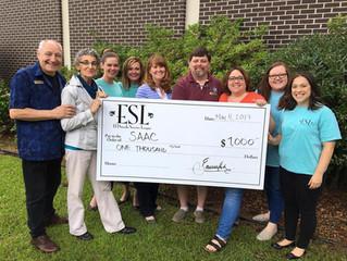 ESL donates $1K to SAAC