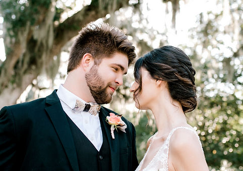 couple in love bowtie wedding updo