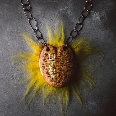 Niziblian: Dechrau neckpiece
