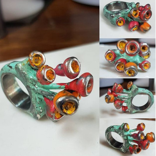 A version of the Yn Barod ring with coloured patination