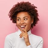 satisfied-carefree-female-model-smiles-g