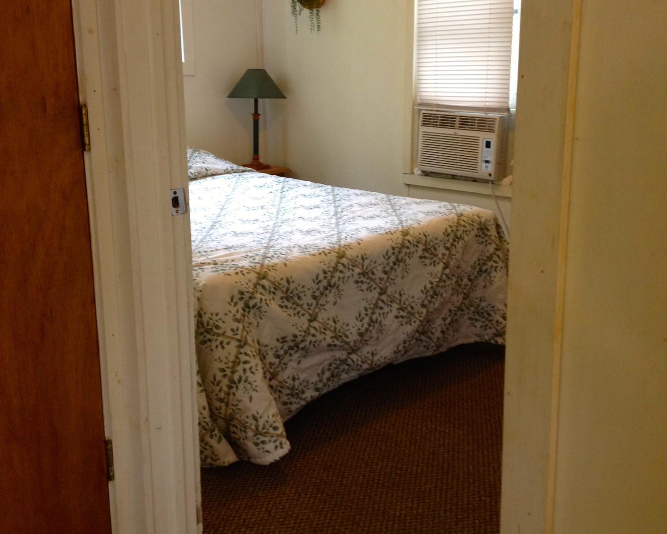 Queen Bedroom with Window AC Unit