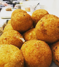 Traditional Rice Balls - Ground beef, mozzarella and peas 🇮🇹🤤 on the counter now!