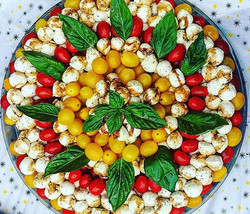 Bocconcini and Cherry Tomato Platter with a balsamic glaze, topped with fresh basil made this past M