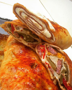 Fresh Mozzarella Stromboli (top) with a Sweet Sausage and Peppers Stromboli (bottom)👀🔥🇮🇹 CALL U