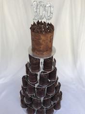 Tower of Choc Mud/Dark Choc ganache piped Main cake & Naked mini cakes