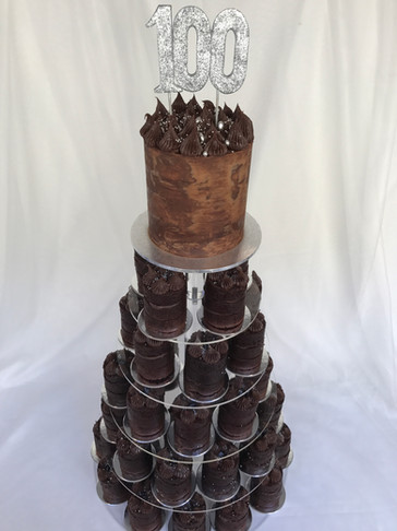 Tower of Choc Mud/Dark Choc ganache piped Main cake & Naked mini cakes