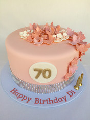 Peach coloured delight topper with Bling, topper with fondant Butterflies & Flowers