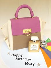 3D scuplted 'Salvatore Ferragamo Handbag cake with Handmade fondant Chanel No. 5 bottle-Coconut cake with White Choclate ganache