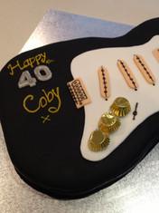 Full-sized 3D scuplted 40th Birthday Guitar cake