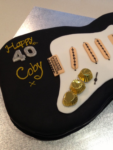 Full-sized 3D scuplted 40th Birthday Guitar cake
