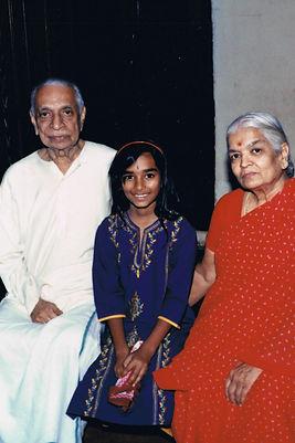 Akila and grandparents.jpg