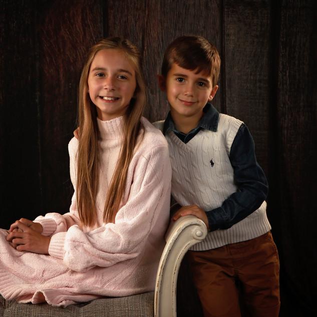 Siblings on Woodgrain