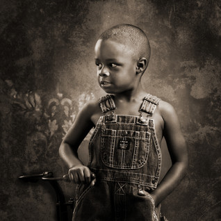 Boy in Overalls - Sepia Portrait