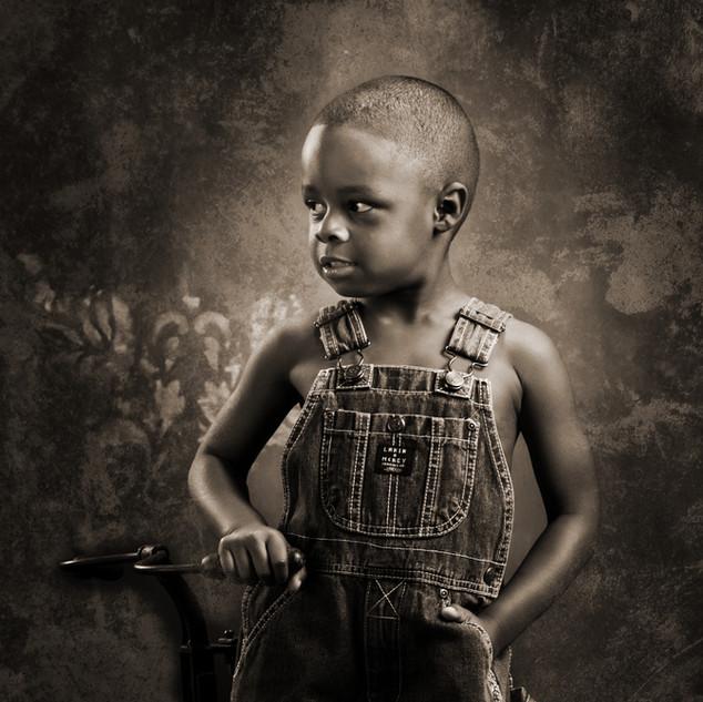 Boy in Overalls - Sepia Portrait
