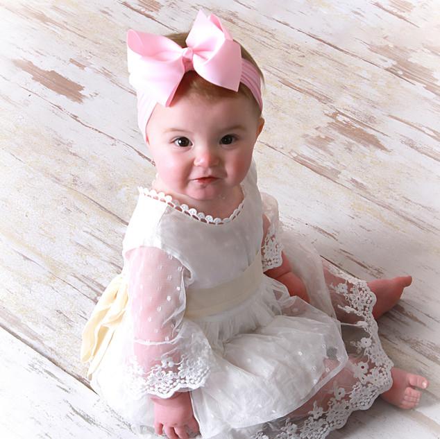 Baby on White Floor