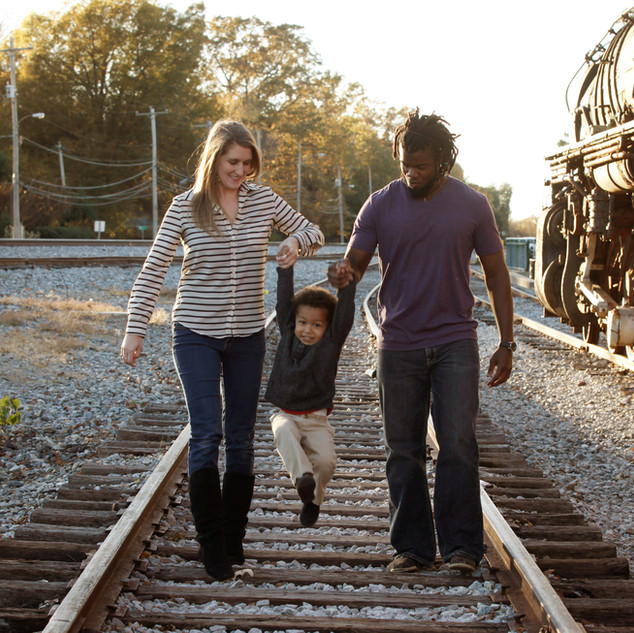 Family Portrait on Railroad Tracks